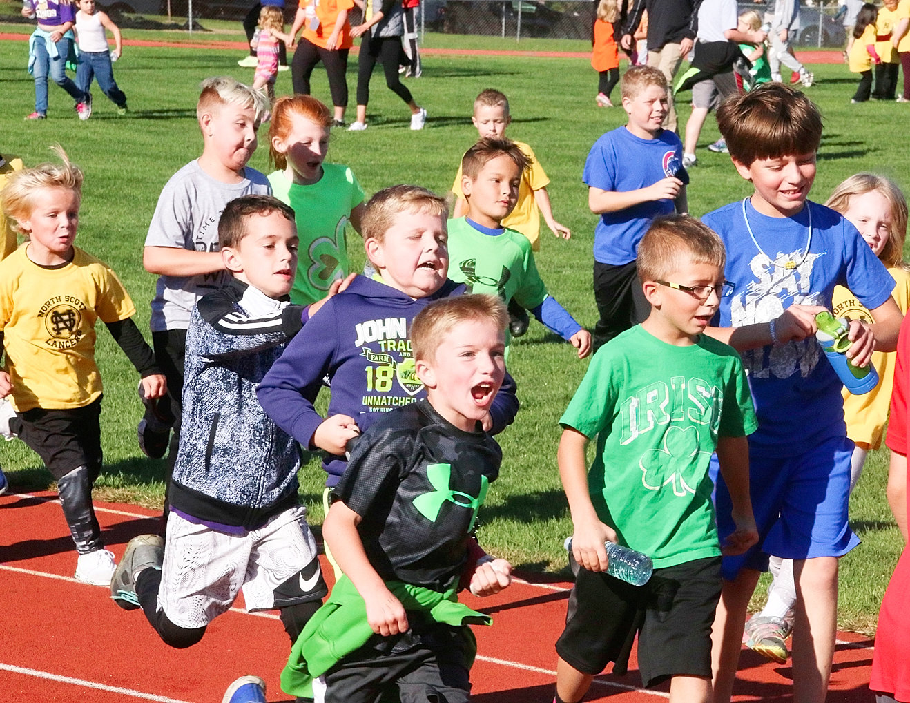 After taking a brief break, these Neil Armstrong students couldn't wait to get back on the track. From left: Cruz Allison, Ian Dexter, Cooper Sebastian, Mackenna Johnston, Jimmy Row (purple shirt), Miles Unwin (front), Olly Lee, Connor Allison (yellow shirt in back), Nick Schryver, Trenton Roe (green shirt), Andrew Row and Julia Krzyzanowski.