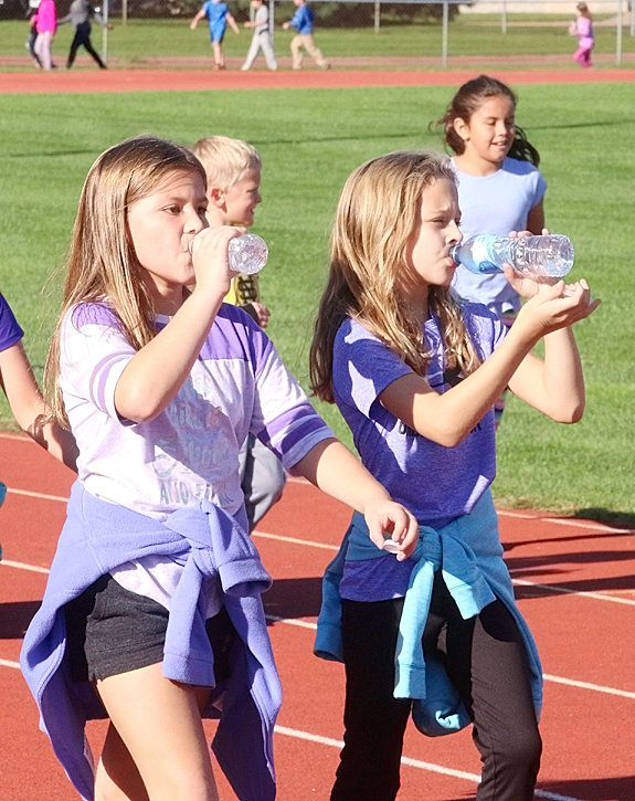 Katy Honeywell and Jenna Weime proved that they were multi-taskers by drinking water and walking at the same time.
