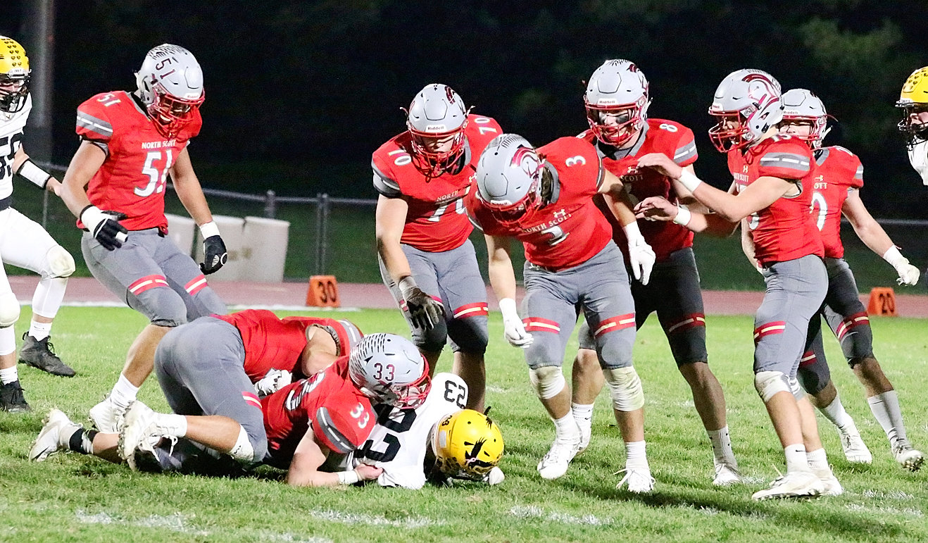 The North Scott defense was dominant all night, and Go-Hawk ball carriers, like Reese Schumacher (23), found it tough going.  Lancer defenders who were Johnny-on-the-spot included (l-r): Gabe Stricker, Mason Watts, Garrett Willey, Dalton Hanenburg, Kade Sandknop, Ben Belken, Carson Rollinger and Nate Link.