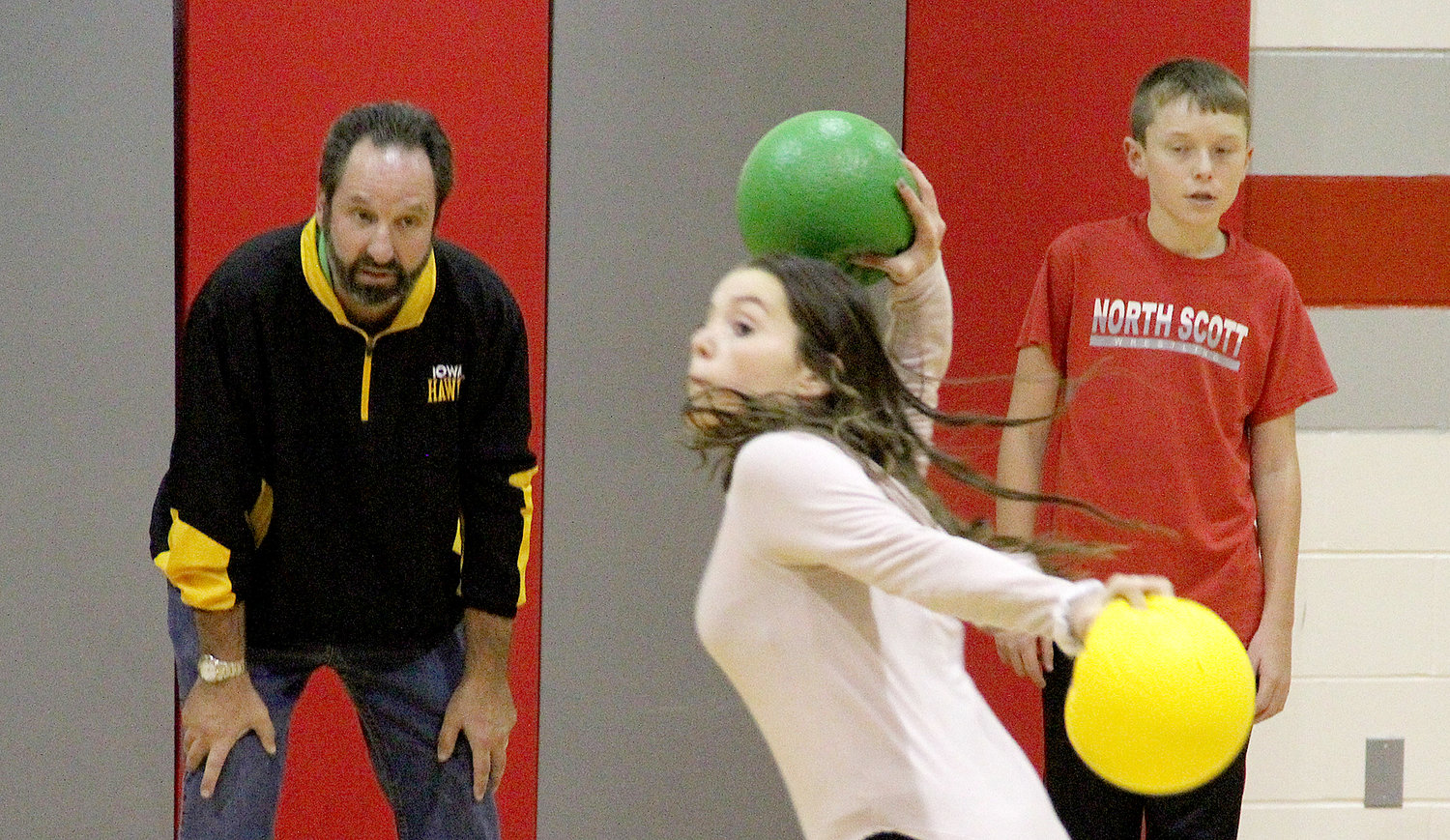 Mr. Dave Koranda (left) keeps a watchful eye on this fast-paced game of dodge ball.