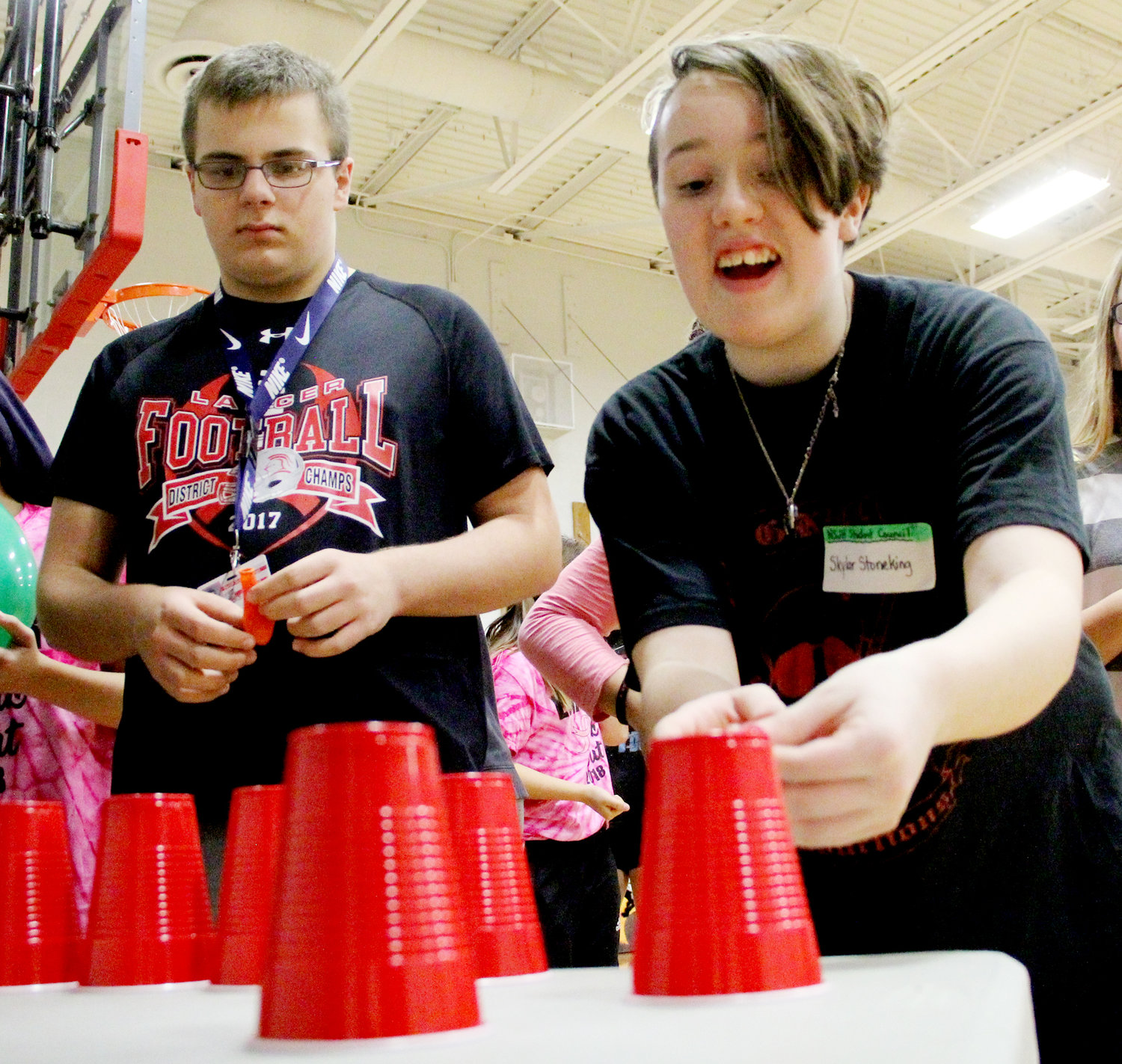 Skylar Stoneking attempts a tricky cup-stacking maneuver.