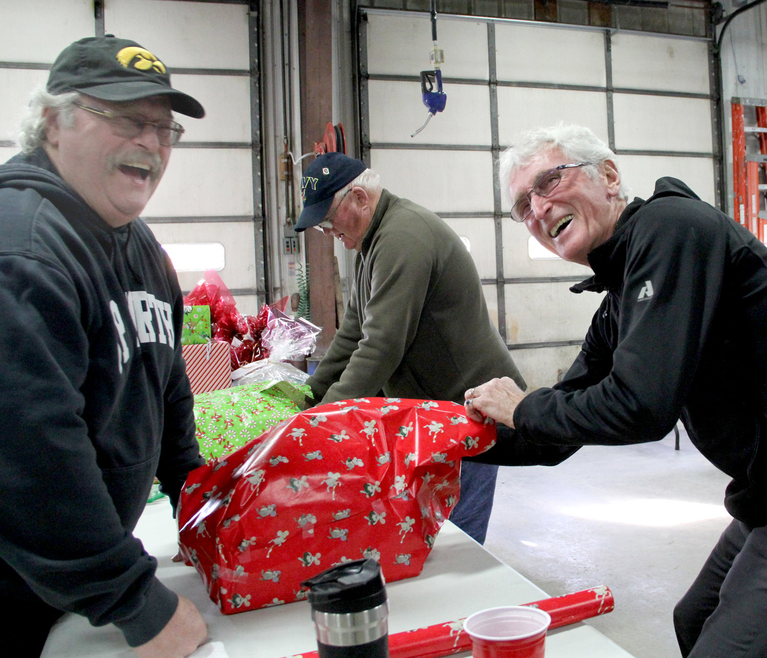 Bob Pfiffner, Craig Ripple and John Thier add another gift.