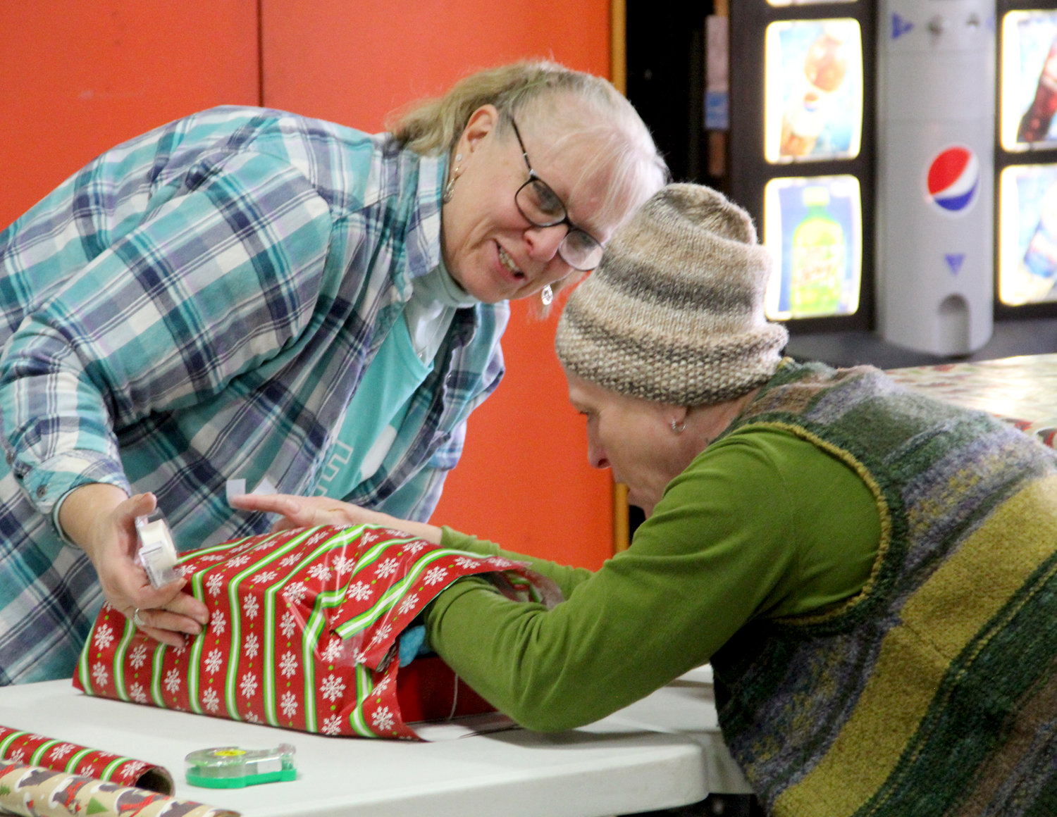 Sharon Alexander and Carol Roe team up on gift wrapping.