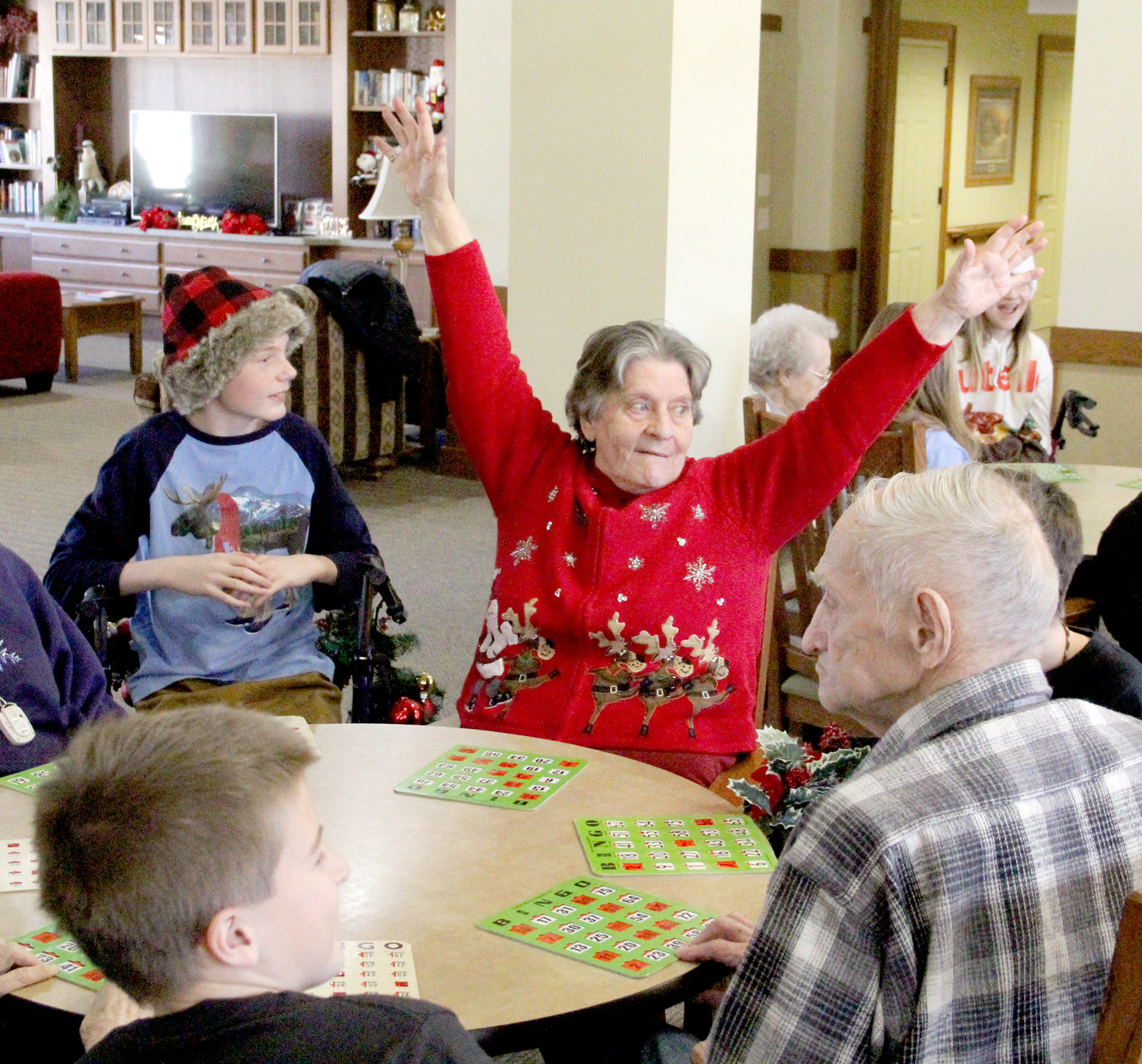 "Germaine Wilmott shouts ""bingo"" at a table with students Collin Meinart and  Zander Pewe."