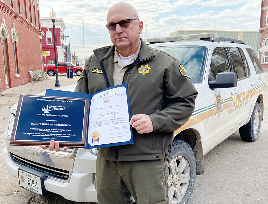 Cedar County Sheriff Warren Wethington is shown above with two awards he received in late 2019 in the wake of a public refusal of the Durant Police Department to process arrestees in Cedar County until then officer Bob Smith was no longer with the force.