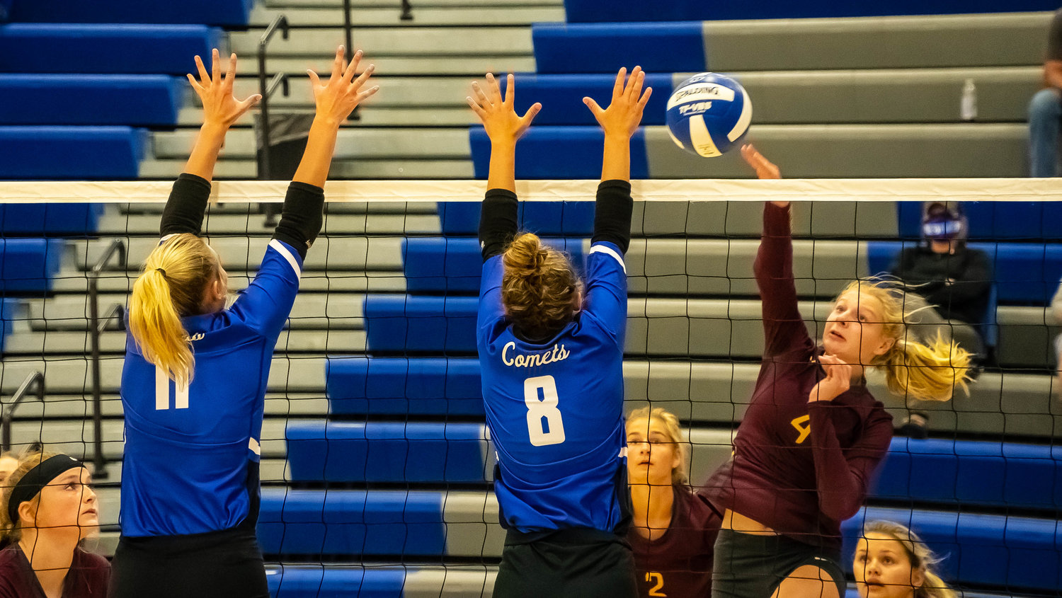 Averi Goodale and Brooklyn Buysse go up for a block in tournament action.