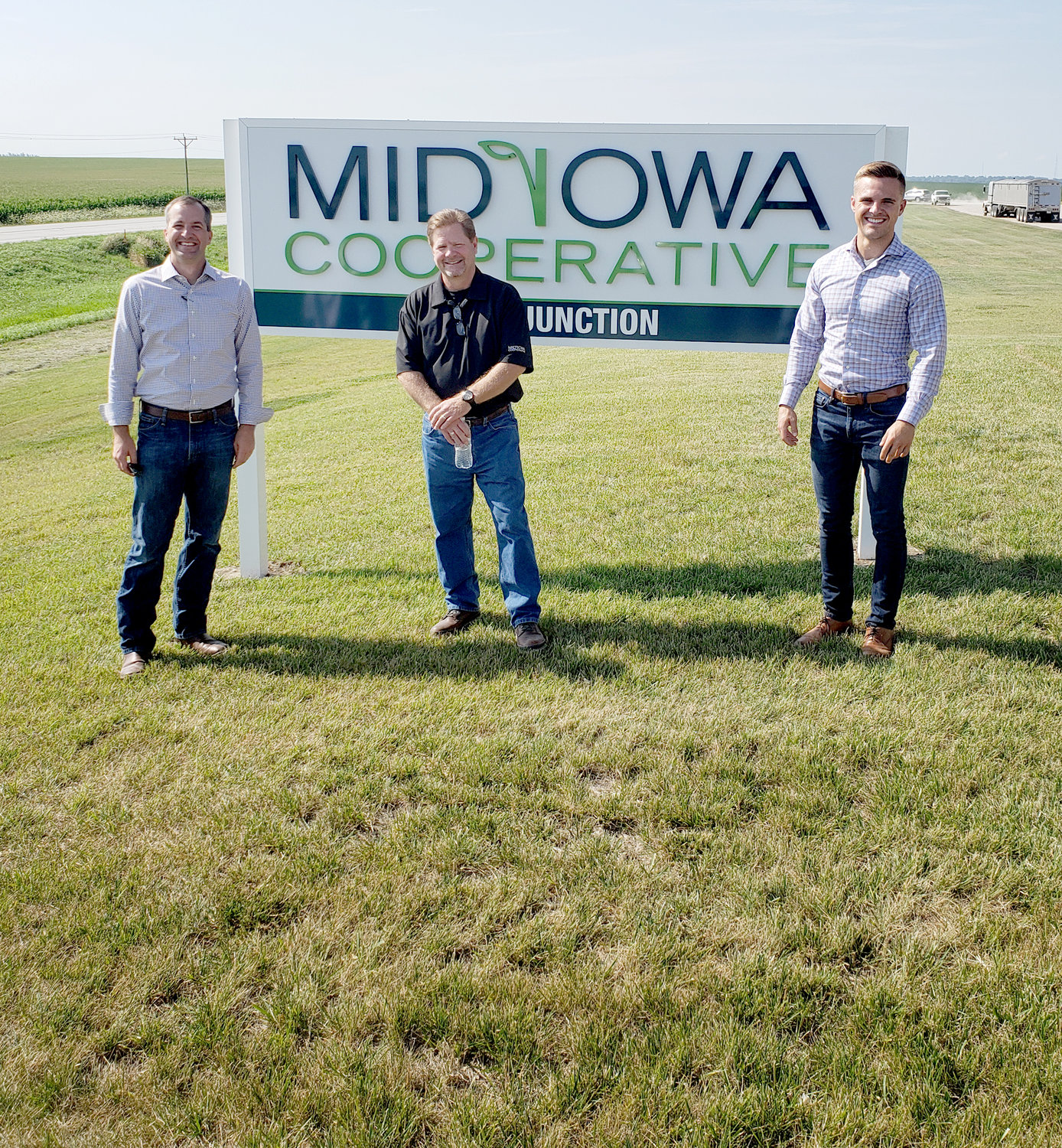 From left: Iowa Secretary of Agriculture Mike Naig, Mid Iowa Coop CEO Mike Kinley and Naig's special assistant and policy advisor  Alex Freeman.