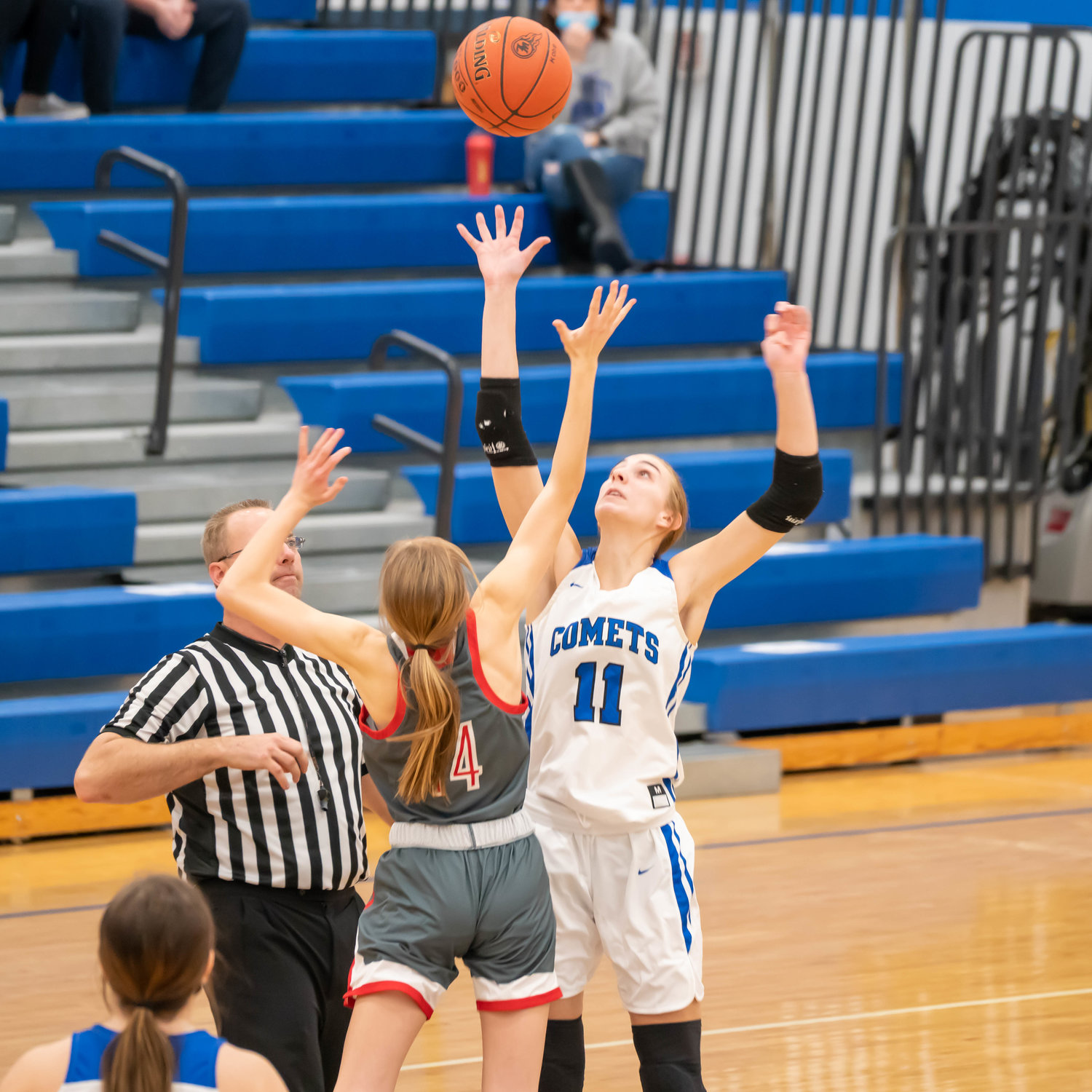 Macy Daufeldt goes up for the opening tip against North Scott.