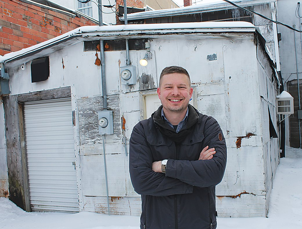 Ethan Anderson stands at the rear of his Big Imprint building he plans to remodel thanks to a $25,000 grant from the city.