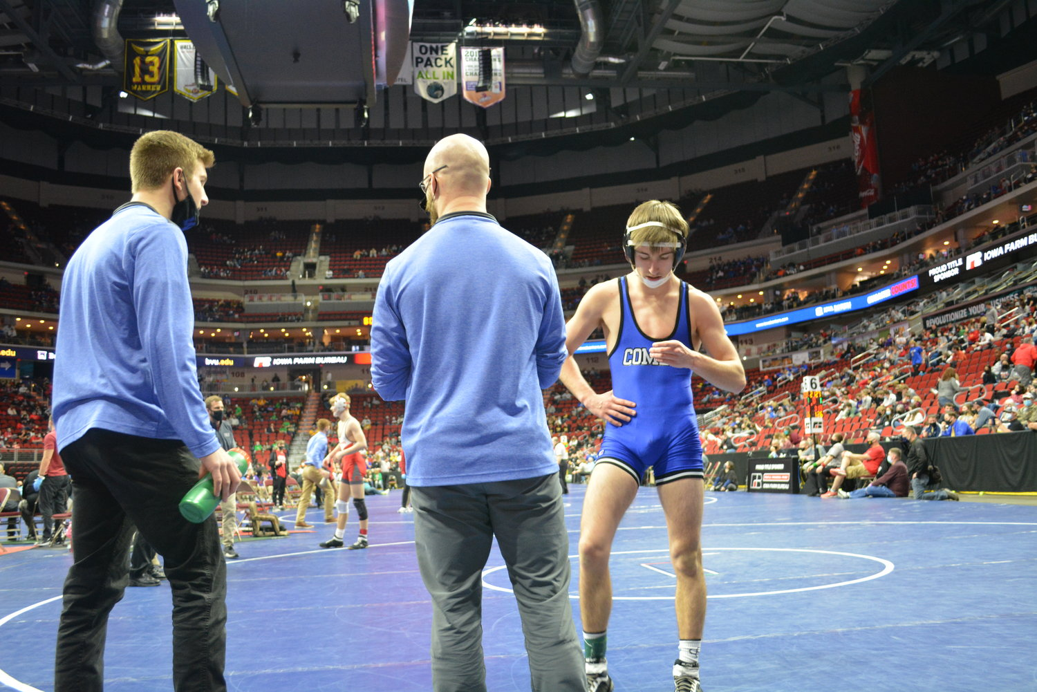 Alex Beaver gets advise from coaches Ian Alke and Austin Beaver at state last week.