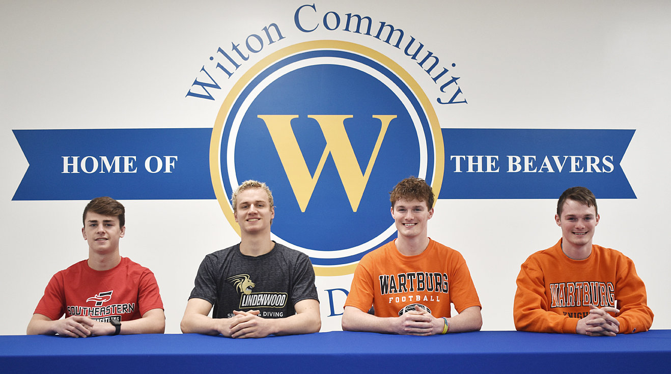 In collaboration with the Wilton-Durant Advocate News, Wilton High School held its first ever signing day for senior student-athletes who have recently signed to play college athletics. Signing day was held April 21 in the Wilton 7-12 Media Center. Pictured  are male student-athlete signees (from left) Kael Brisker, who plans to wrestle at Southeastern University in Lakeland, Florida; Ryan Boeding, who plans to swim at Lindenwood University in St. Charles, Missouri; and Colby and Caleb Sawvell, who plan to play football at Wartburg College in Waverly.