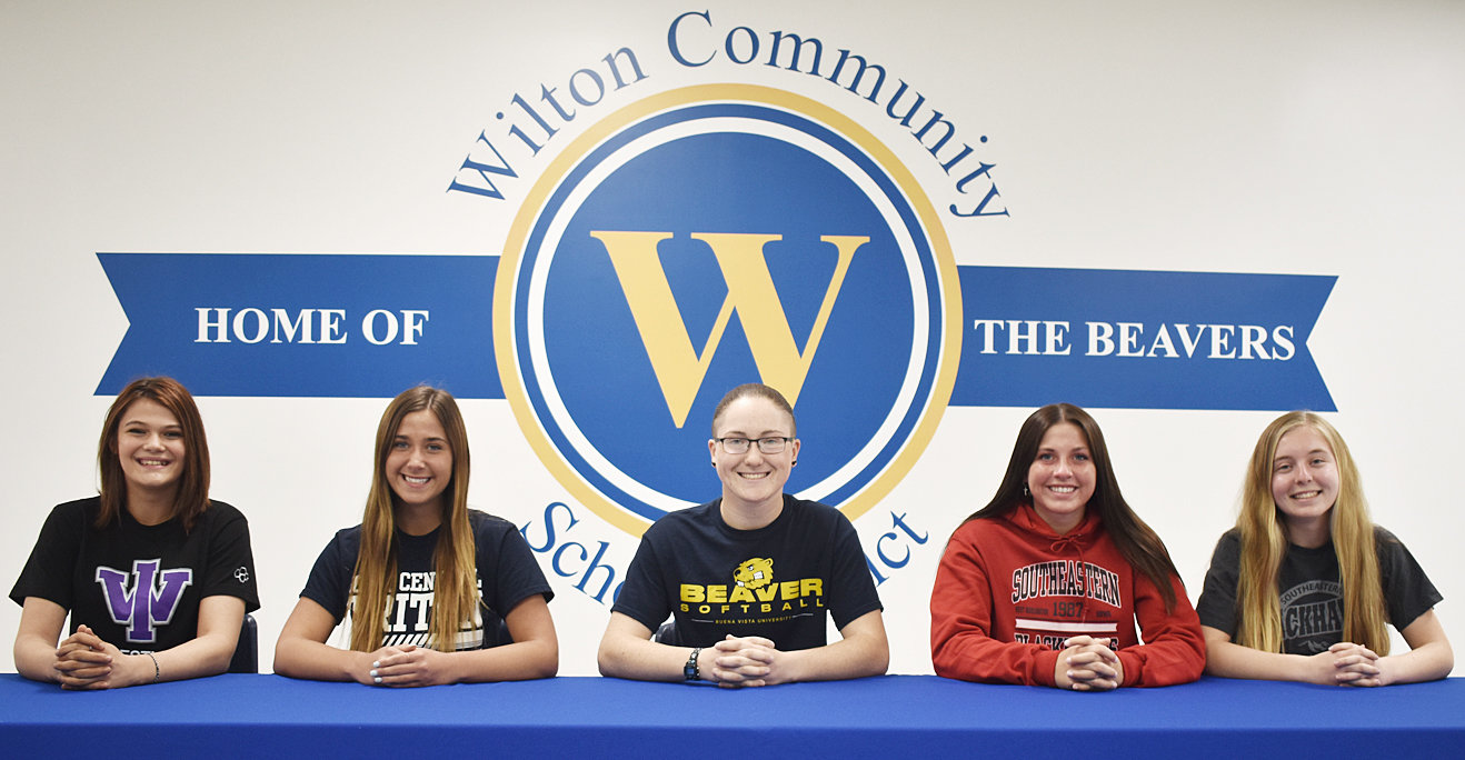 Pictured are female student-athlete signees (from left) Mea Burkle, who plans to wrestle at Iowa Wesleyan University in Mount Pleasant; Jayden Everson, who plans to dance at Iowa Central Community College in Fort Dodge; Chloe Wells, who plans to play softball at Buena Vista University in Storm Lake; Ansley Boorn, who plans to play softball at Southeastern Community College in West Burlington; and Josie Said, who plans to play softball at Southeastern Community College in West Burlington.
