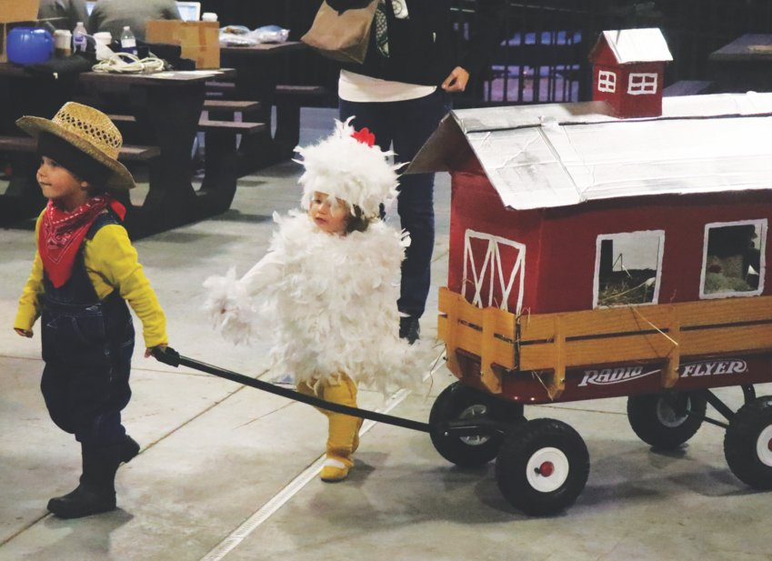 Tiny farmer Rowan Flentge and his sister, Isla, dressed as a chicken, won first place in the duo category during the 2019 Moonlight Madness kids costume contest on the square in downtown Perryville. This year, the event will go on as planned, but there will be no costume contest, one of several changes attendees wills see.