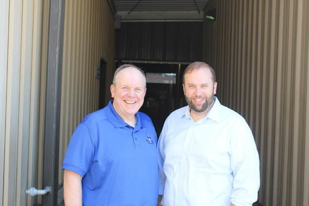 Gilster-Mary Lee President Tom Welge, meets with and Congressman Jasom Smith earlier in June outside the Perryville cereal plant.