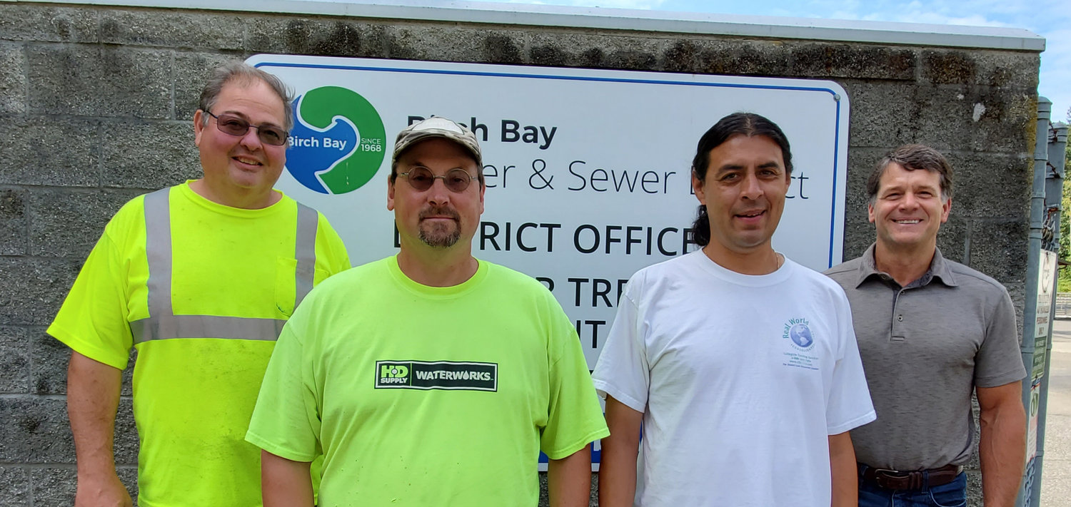 The Birch Bay Water and Sewer District's wastewater treatment plant team. From l., Mike Trueblood (foreman), Shane Hess (operator), Lawrence Gonzales (operator) and Mike Sowers (operations manager).