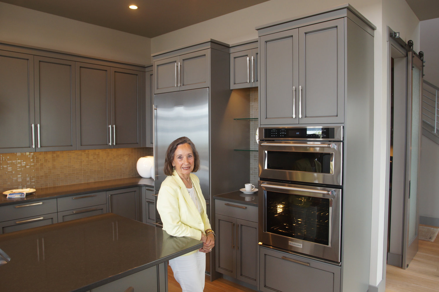 Markie Nelson stands in a kitchen that she designed in one of the model homes at Semiahmoo Shore.
