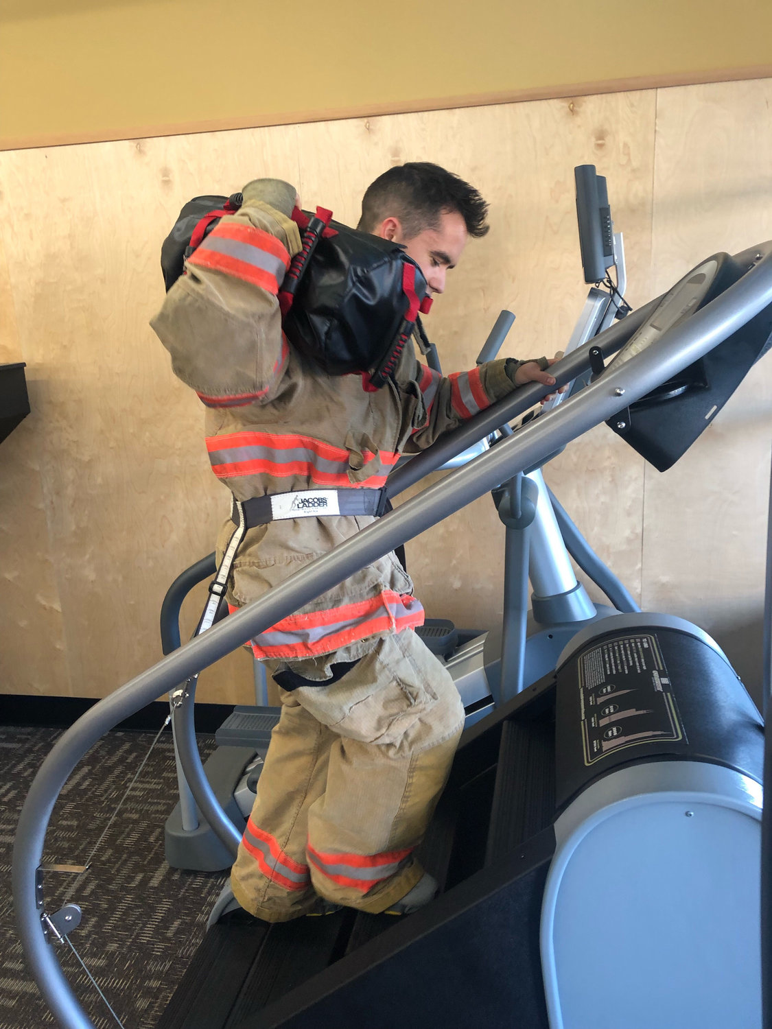 Anytime Fitness Blaine owner Mike Andes demonstrates the 110 Floor Stair Climb challenge.