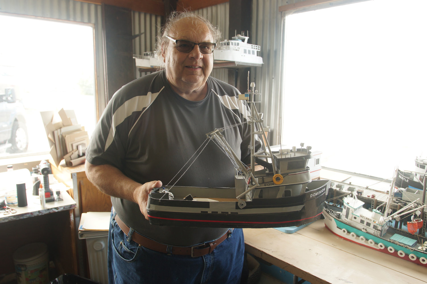 Mike Dodd with one of his favorite model boats.