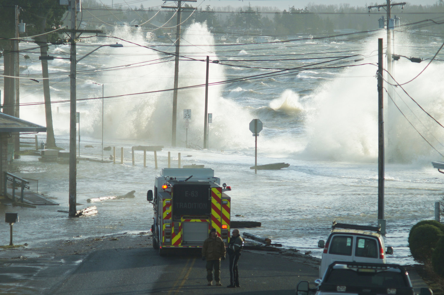 "A windstorm and high tide pushed water over the roadway at Birch Bay Drive on December 20, 2018. The berm project will place about 210,000 tons of sand and gravel on the beach to ""renaturalize"" it and guard against storm surges."