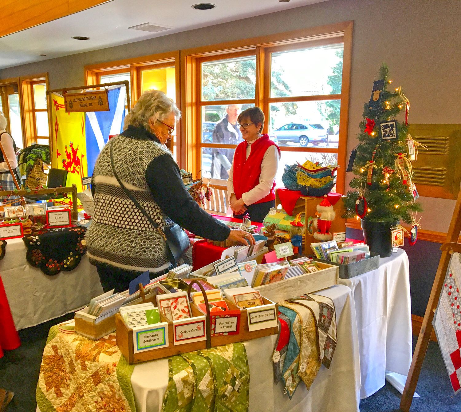 A shopper browses items for sale at last year's holiday boutique and craft fair hosted by the Semiahmoo Women's Club.