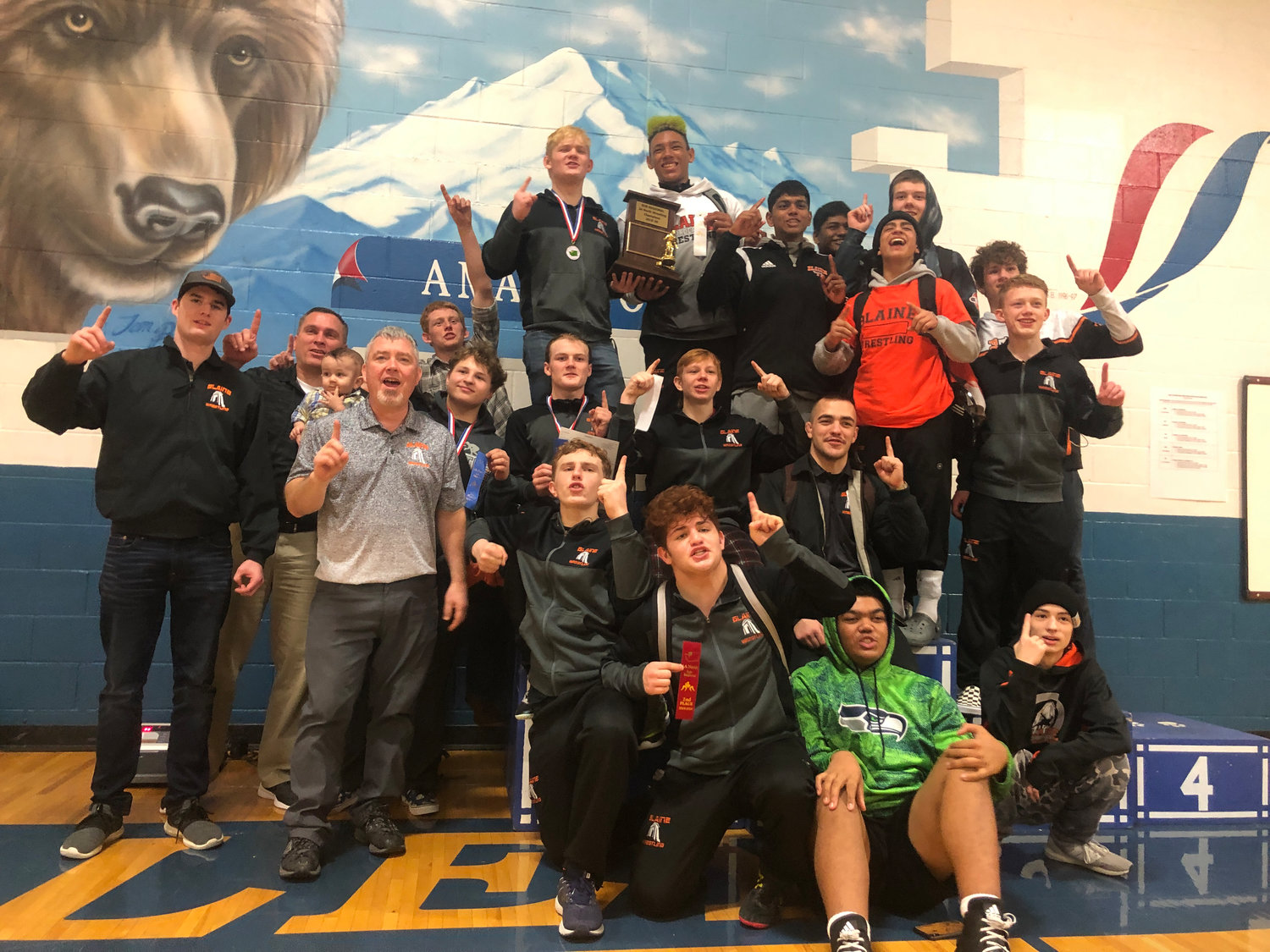 Blaine wrestlers celebrate after winning the Class 2A Sub-Regional wrestling tournament at Sedro-Woolley High School on February 8.