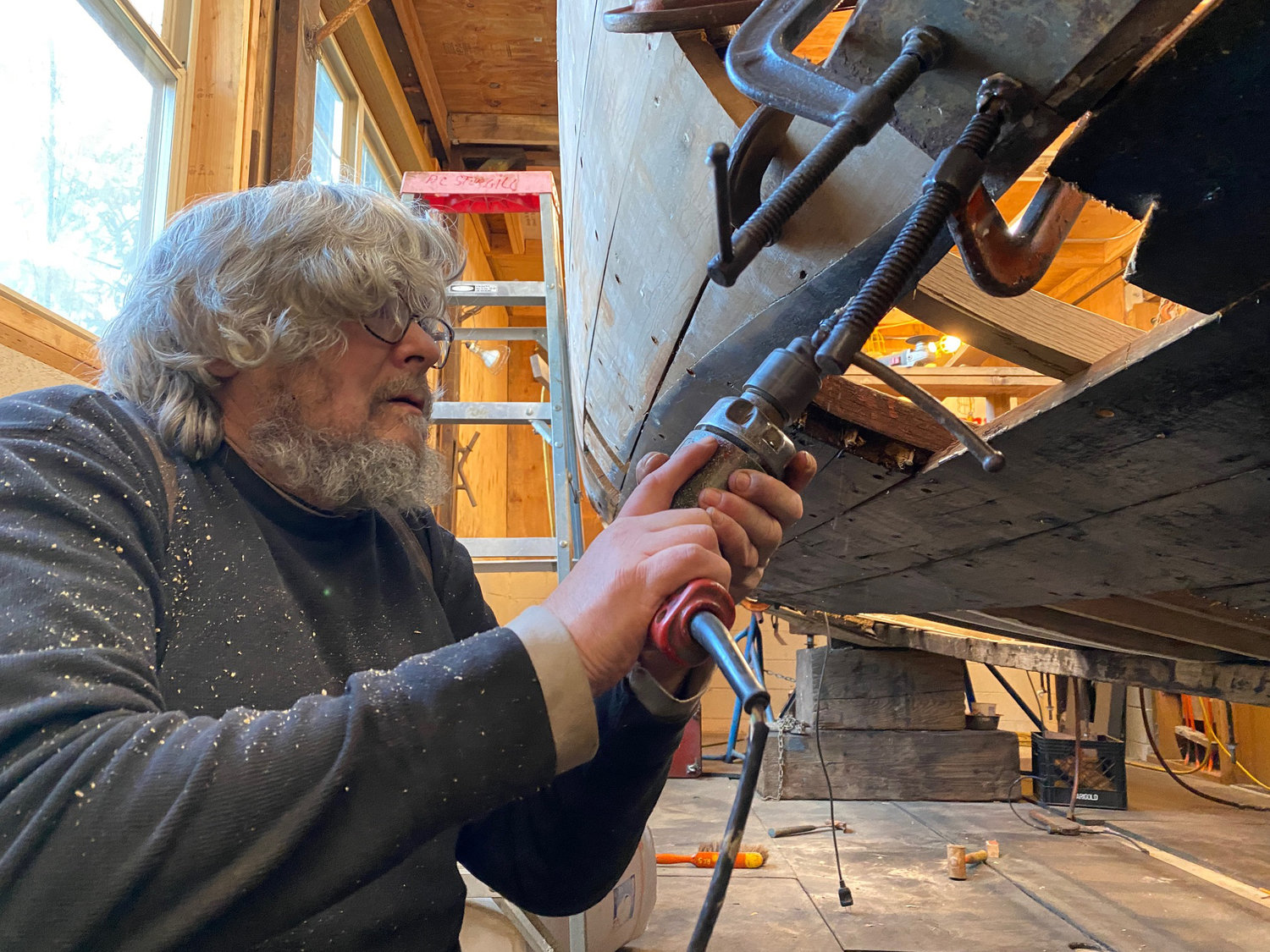 Steve Alaniz, a shipwright, performing restoration work on the vessel. Alaniz once worked for the same Alaska cannery that the boat originally fished for.