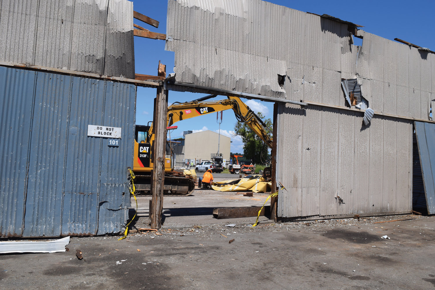 Port of Bellingham contractor Lautenbach Recycling works on demolishing a marine storage building at the end of Marine Drive on July 13.
