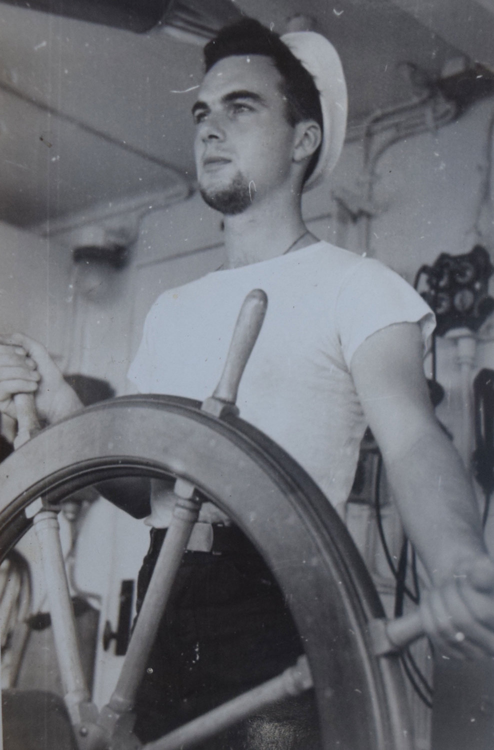John Finn in November 1944, at 24-years-old, working on a U.S. Coast Guard freight supply ship during WWII.