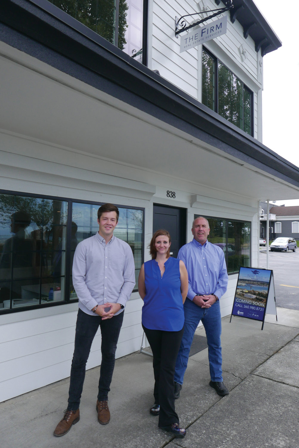 From left: Michael Hughes, Cesilie Gile and Chris Hughes of The Firm Real Estate Services outside the company's office at 838 Peace Portal Drive in Blaine.