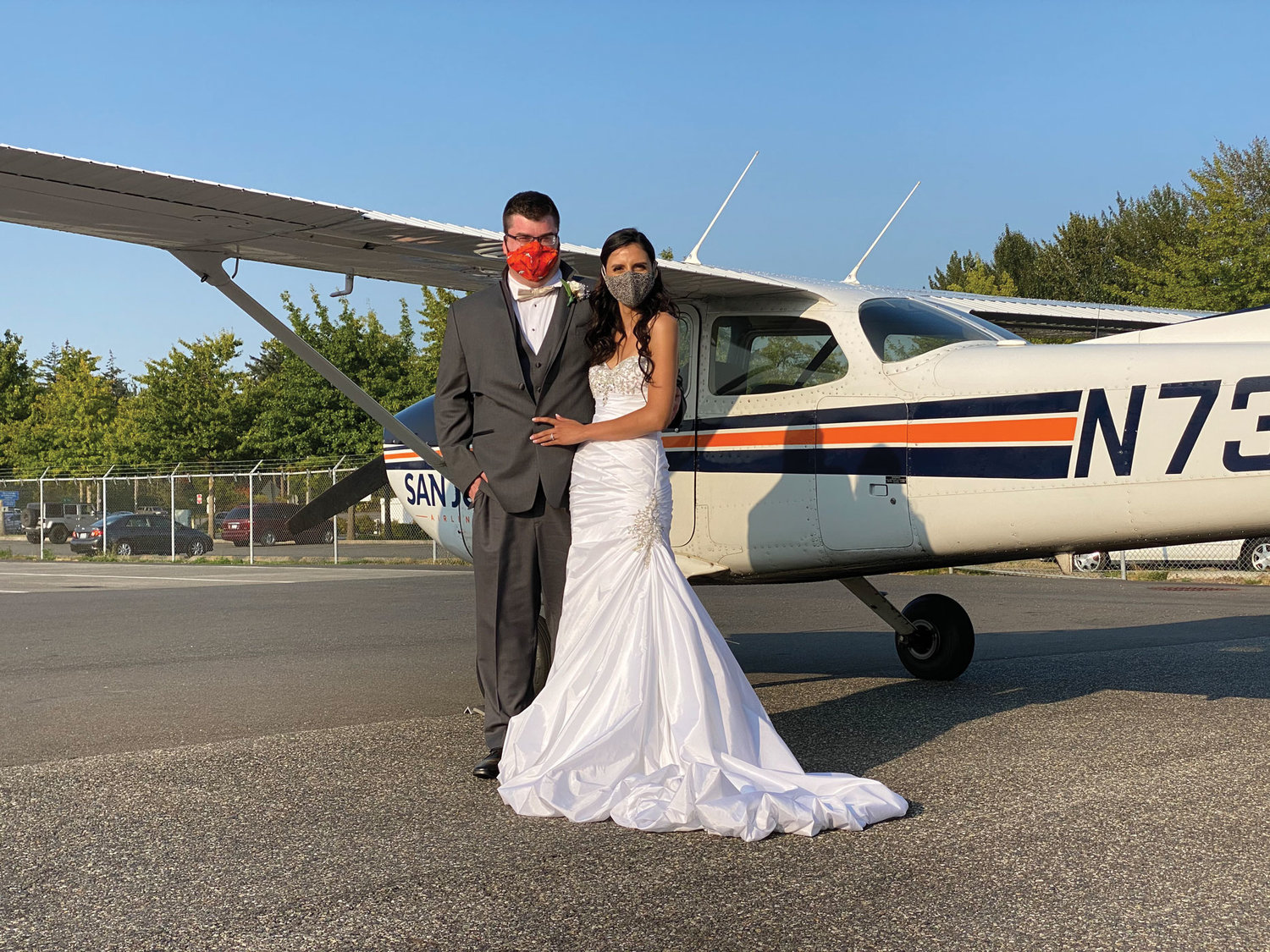 Alex, 25, and Alma, 25, at Bellingham International Airport after their wedding on September 6.
