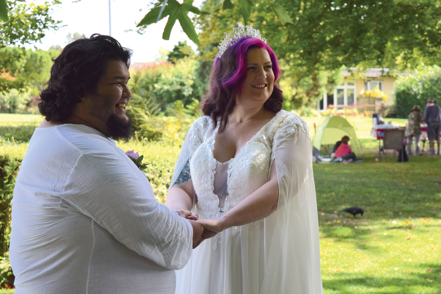 Daniel Frausto, l., and Elizabeth Rodriguez performing their wedding ceremony at Peace Arch Park on September, 2.