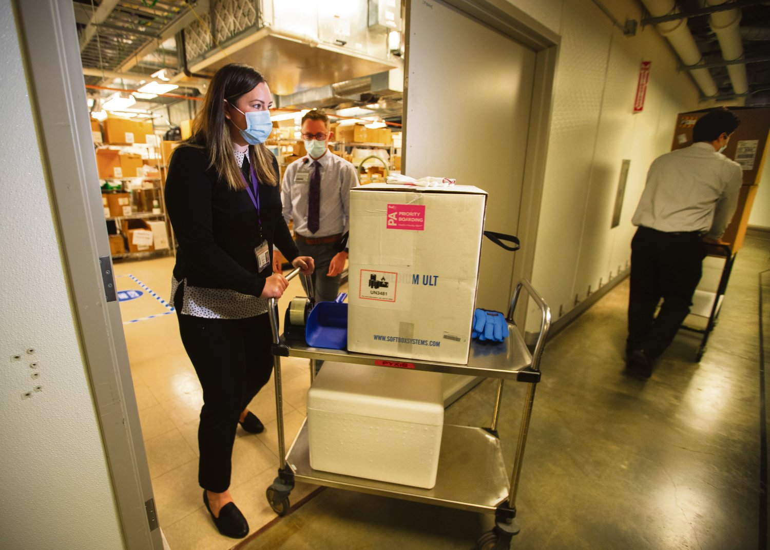 WA DOH POOL PHOTO - UWMC Pharmacy Manager Christine Meyer puts a tray of 975 doses of Pfizer's coronavirus vaccine into the deep freeze after the vaccine arrived at UW Medicine's Montlake campus Monday morning, December 14, 2020. These are among the first to be distributed in Washington state...A total of 3,900 doses arrived at the UW on Monday that will be distributed among UW Medicine's four hospital campuses...Photographed on December 14, 2020.