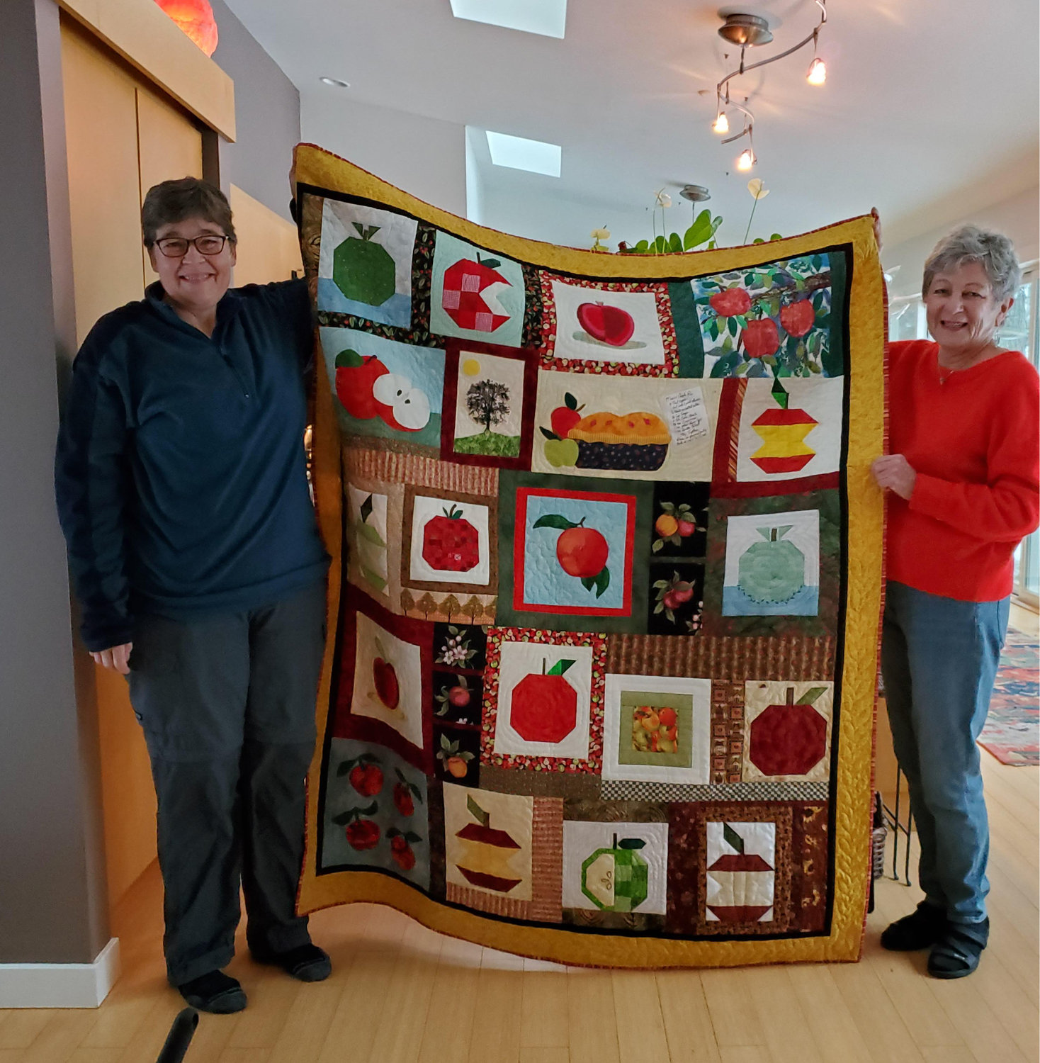 Bronwyn Glor, l., held the winning raffle ticket for the Circle of Care quilt. She is seen here with Galen Wood.