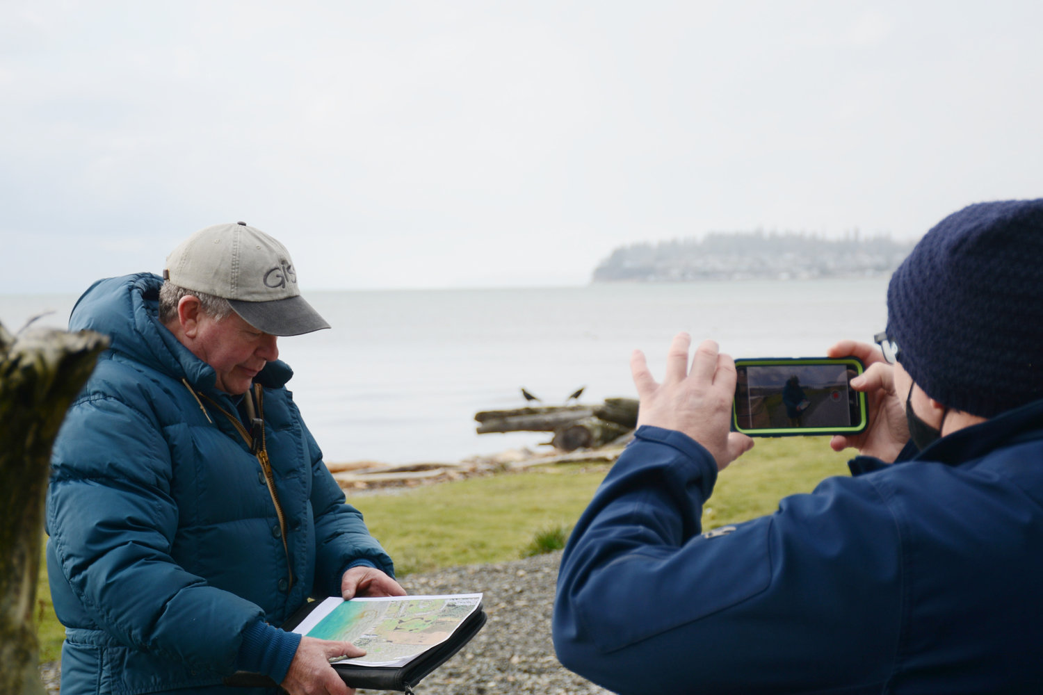 Local geologist Mike Price of Entrada/San Juan Inc. discusses the history and features of the Birch Bay berm on February 8. Price is working with Dan Lang of video editing service DLS Media to make a virtual tour of the unfinished berm.