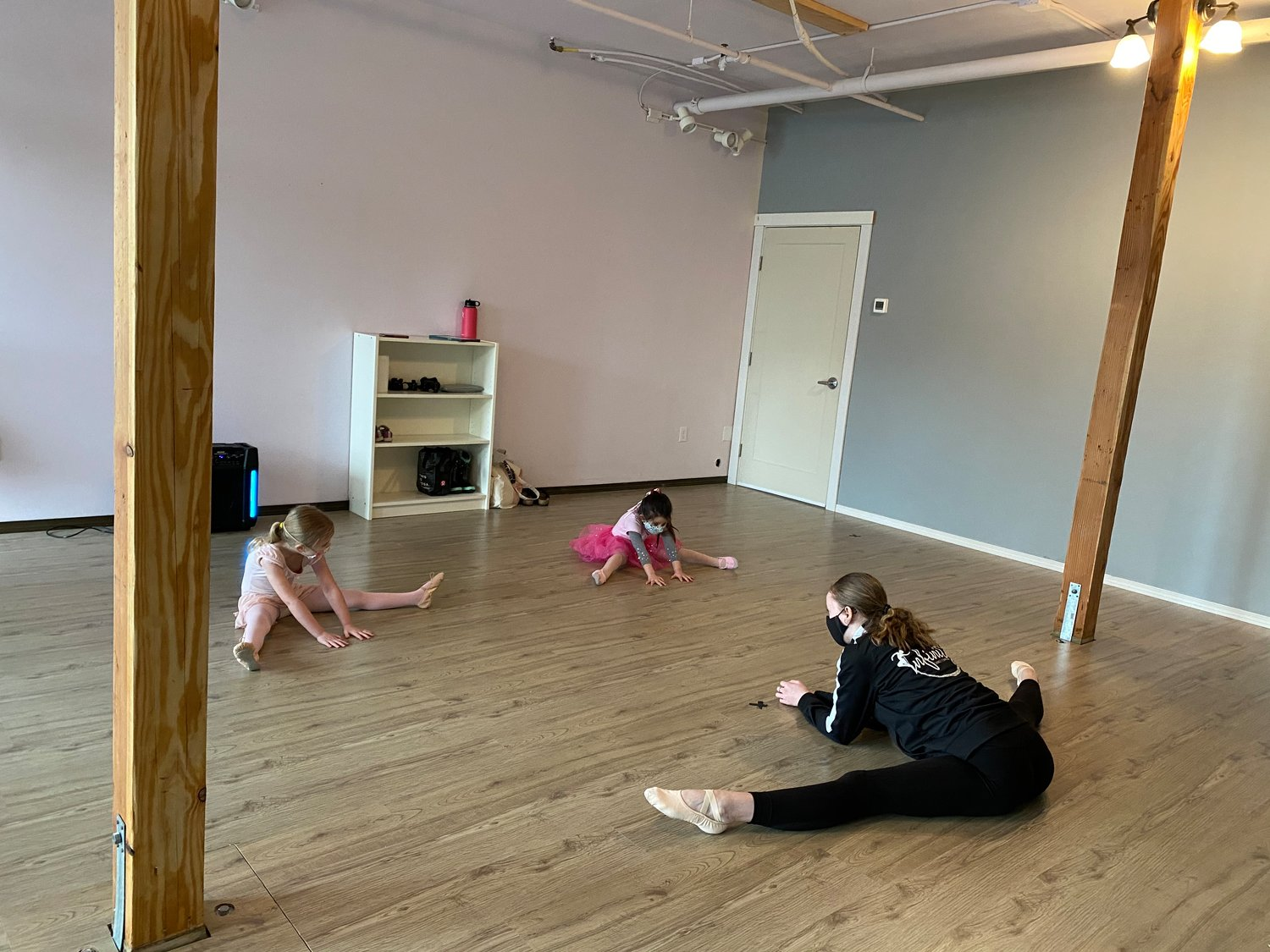 Dancers warm up during their pre-ballet class at Infinity Dance Studio in Birch Bay.