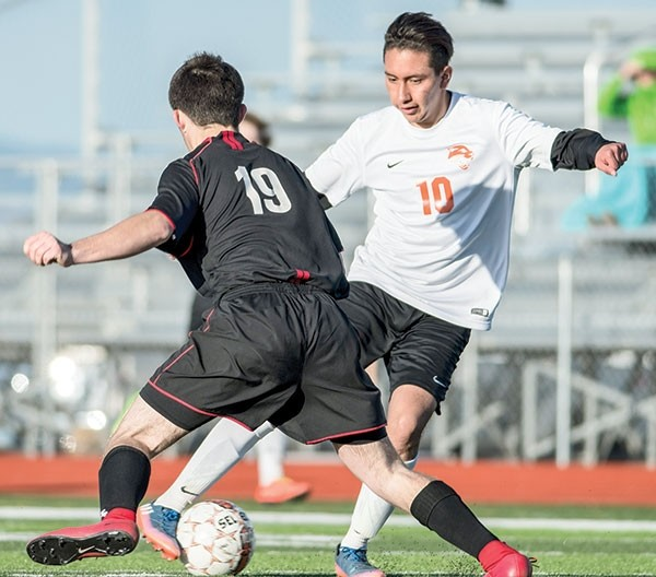 Panther forward Luis Gutierrez maneuvers around a Riverton opponent during a game at Panther Stadium earlier this season. The rematch Friday in Riverton resulted in a 1-1 tie.