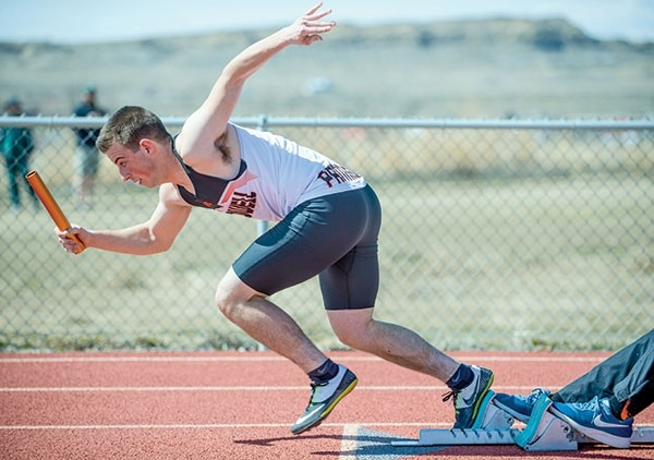 Panther runner Jon Morrow leaps off the starting blocks during the 4x100 meter relay during a recent track meet at Rocky Mountain High School in Cowley.