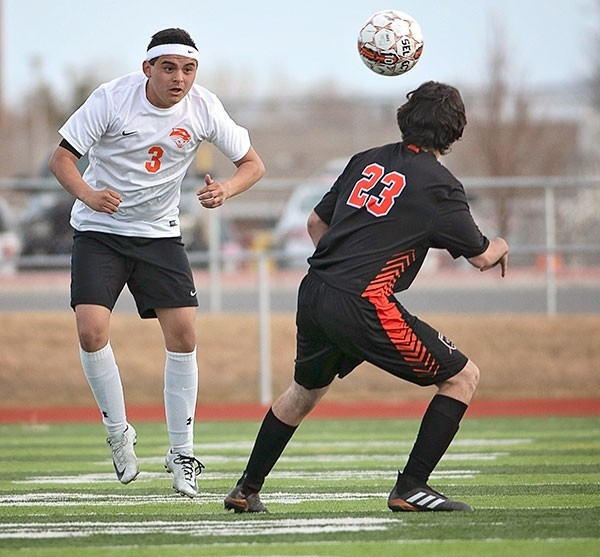 Panther midfielder Ernie Acevedo battles a Worland opponent for the ball in a Monday game at Panther Stadium. The top-ranked Warriors were able to outlast the Panthers for a 1-0 win.