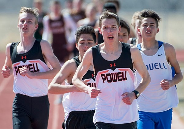 Powell runner Alan Merritt leads the pack during the second lap of the 1600 meter run, followed by teammates Tyler Pfiefer (left) and Jayden Yates (far left) at Saturday's Rocky Mountain Invite in Cowley.