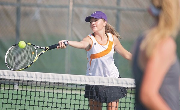 No. 2 doubles player Heidi Barrus returns a shot last fall for the Lady Panthers tennis team. Barrus and her doubles teammate Sloane Asay will compete this weekend at the Cody Invitational.