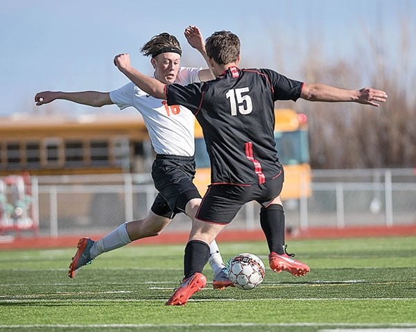 PHS freshman Sam Bauer (left) battles for the ball against a Riverton Wolverine during a Friday home game last week. Bauer scored one of Powell's two goals against the Worland Warriors on Tuesday in Worland.