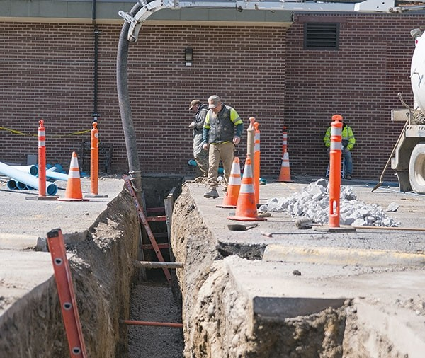 Workers assess their handiwork Monday outside the Johnson Fitness Center on the Northwest College campus. The NWC Board of Trustees recently approved $240,000 to complete upgrades on the center, with work scheduled to wrap up before the fall semester begins in August.