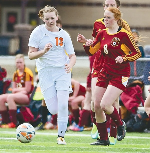 Lady Panther forward Michele Wagner moves the ball past a pair of Star Valley defenders during a Saturday game at Powell High School. The Lady Panthers opened the season with a 1-0 win over Pinedale on Friday before falling to Star Valley 4-0.