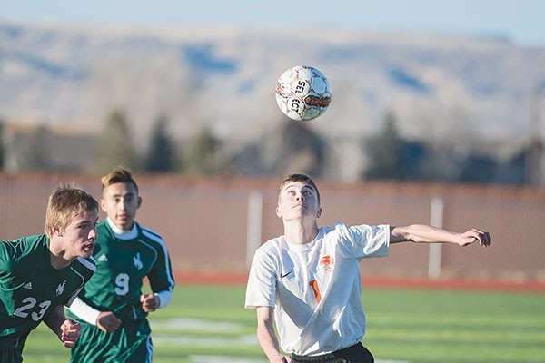 Panther forward Rob Sessions heads the ball toward the goal in a Friday game against Pinedale at Panther Stadium. Powell lost to the Wranglers in overtime, 3-2.