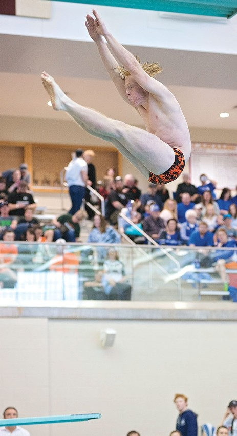 Panther diver Hudson Wilkerson completes a dive en route to his state championship title on Friday at the 3A State Swim and Dive Championships in Laramie.