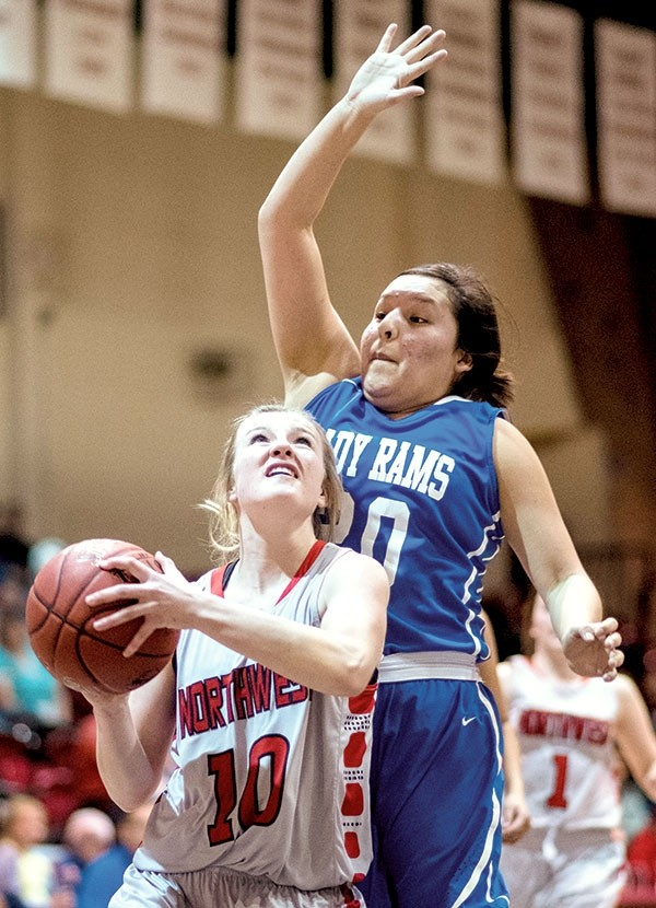 Lady Trapper Shelby Wardell battles for two of her 35 points against Little Big Horn College's Jael Birdinground Saturday in a 117-33 rout at the Cabre Gym. NWC is now ranked second in the Region IX North with three games remaining in the regular season.