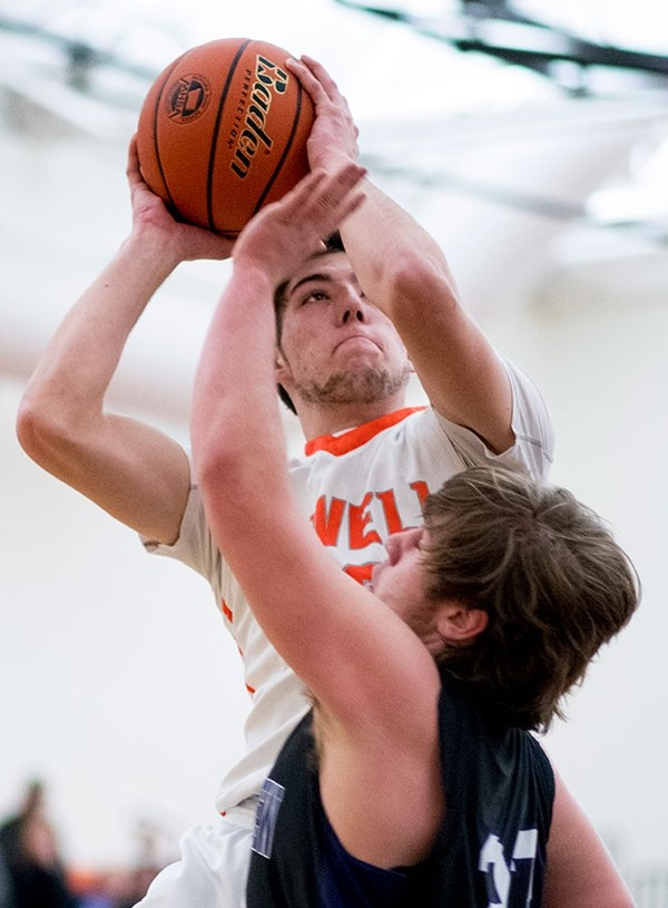 PHS senior Luke Washington goes up for a shot Friday against a Mountain View defender during a game at Powell High School. The Powell boys split a pair of games over the weekend, losing to Mountain View but rebounding Saturday with a win against Lyman.