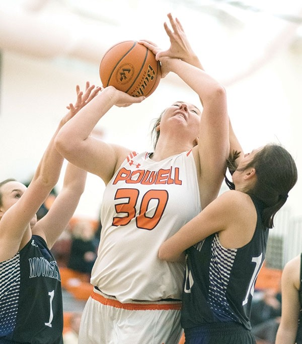 PHS junior Rachel Bonander battles for a shot Friday against a pair of Mountain View Lady Buffaloes at Powell High School. Powell lost the game, 47-33.