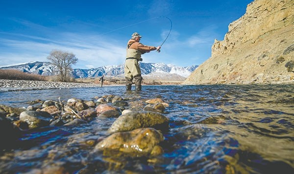 Tom Reed, East Yellowstone Chapter of Trout Unlimited president, and Tim Wade, owner of North Fork Anglers in Cody and Trout Unlimited lifetime member, fly fish the Clarks Fork of the Yellowstone River near the Beartooth Ranch, also known as the 'drug ranch.' Park County commissioners want the state to give the property to the county — an idea that Reed and Wade oppose.