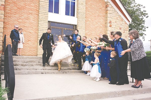 Angela and Trevor Carpenter of Powell run down the steps in front of Union Presbyterian Church on their wedding day, Sept. 23, 2017. The photo is similar to the one taken of Angela's grandparents' on their wedding day nearly six decades ago. Angela's grandparents, Karla and Donald Gorrell, are at the top of the steps on the left. Her mother, Terri Reinhardt, is in front on the right.